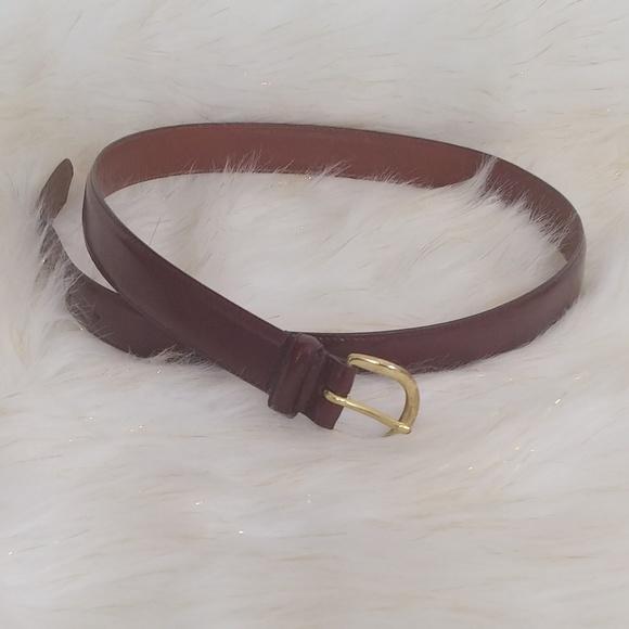 coach. burgundy leather belt, gold buckle